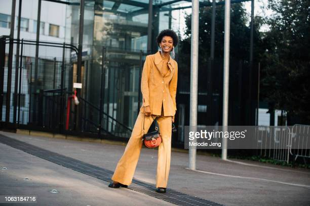 Model Theresa Hayes wears a matching suede light brown top and pants Chloe bag after the Chloe show at Maison de la Radio during Paris Fashion Week...