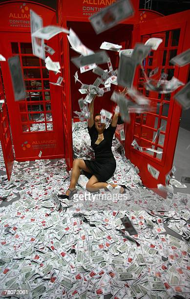Model throws fake money in the air 22 November 2007 at the one of Europe's most exclusive and trend-setting lifestyle trade fairs the Moscow...