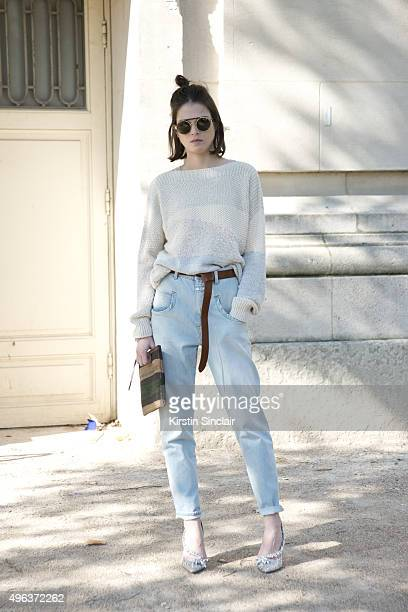 Model Tiffany Cheneg wears Closed jeans bag and top Dsquared shoes and Sandro sunglasses on day 5 during Paris Fashion Week Spring/Summer 2016/17 on...
