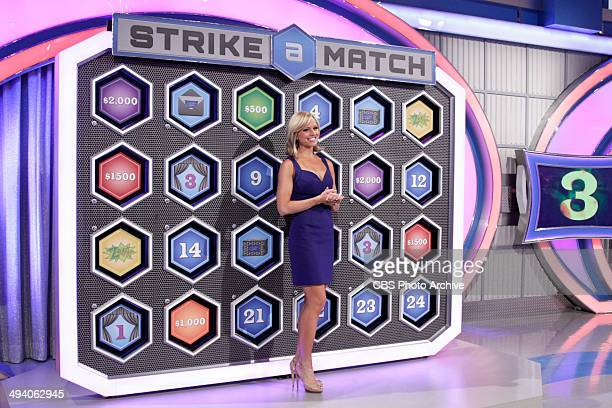 Model Tiffany Coyne stands before the board for the Strike a Match game awaiting her cue for what to turnover next on LET'S MAKE A DEAL airing...