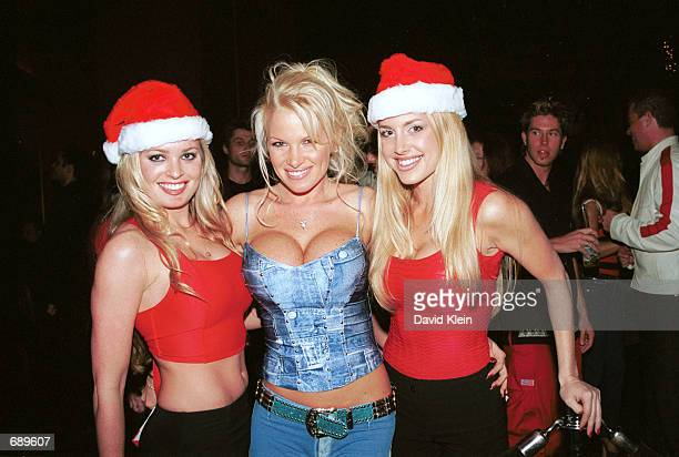 Model Tina Jordan poses with club dancers at Barfly for the Barfly Friday Night Christmas Party featuring Playboy Magazines January 2002 cover model...