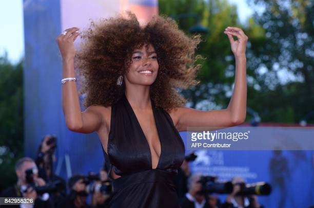 Model Tina Kunakey attends the premiere of the movie 'Mother' presented in competition at the 74th Venice Film Festival on September 5 2017 at Venice...