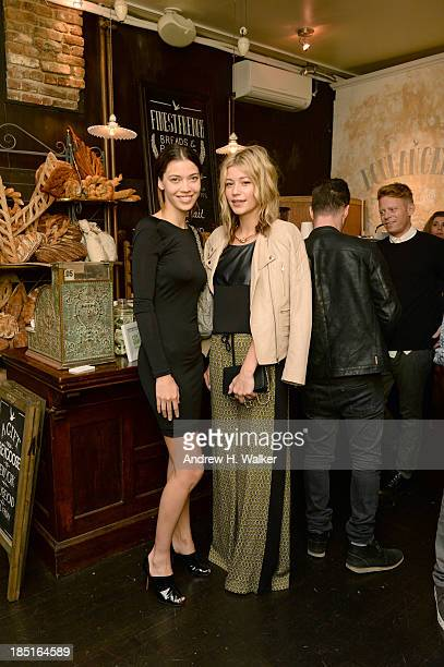 Model Tina Marie Clark and BPCM Erin Cullison pose for a photo as GREY GOOSE Vodka hosts exclusive speakeasy with special performance by Amos Lee at...