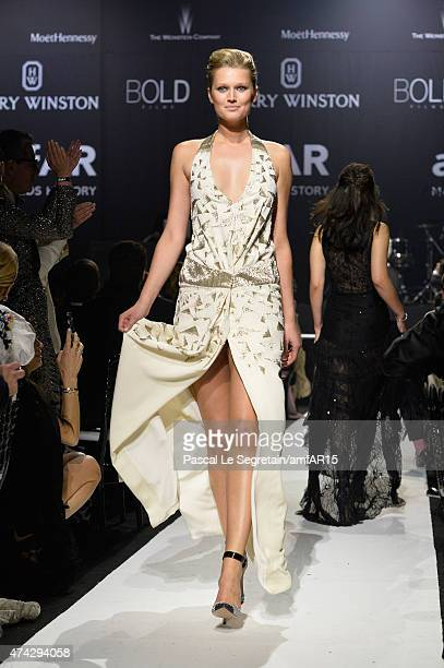 Model Toni Garrn walks during the fashion show runway during amfAR's 22nd Cinema Against AIDS Gala Presented By Bold Films And Harry Winston at Hotel...