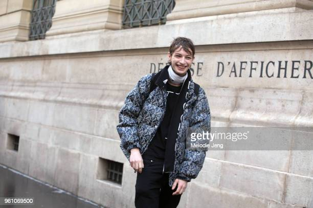 Model Tony Harak wears a Supreme 'FUCK jacquard puffy navy jacket during Paris Fashion Week Mens Fall Winter 2018 on January 19 2018 in Paris France
