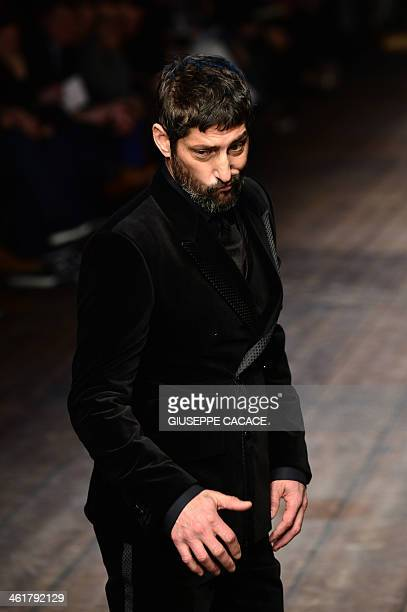 Model Tony Ward presents a creation for fashion house Dolce & Gabbana as part of Autumn/Winter 2014 Milan Collections during the Men's fashion week...