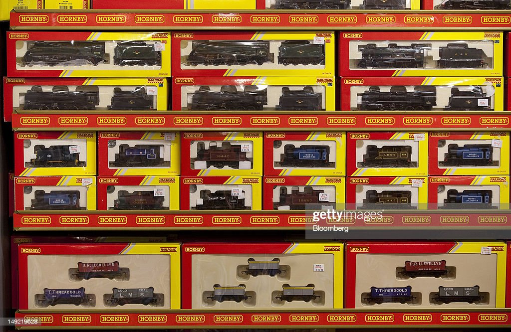 Model train sets, produced by Hornby Plc, sit on display at