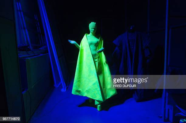 Model trains to walk backstage creations from designer Hu Sheguangs haute couture showcase during China Fashion Week in Beijing on March 25, 2018. /...