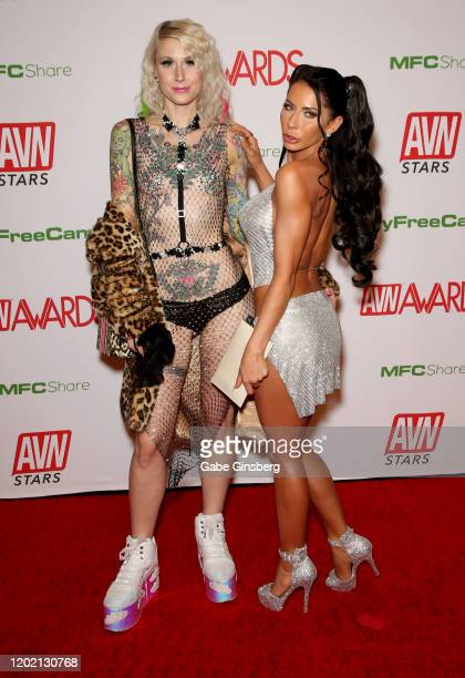 Model Tricia Pain and adult film actress Madison Ivy attend the 2020 Adult Video News Awards at The Joint inside the Hard Rock Hotel Casino on...