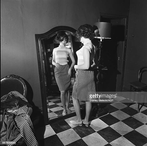 A model tries on a striped skirt at the Biba boutique on Abingdon Road in Kensington London circa 1965