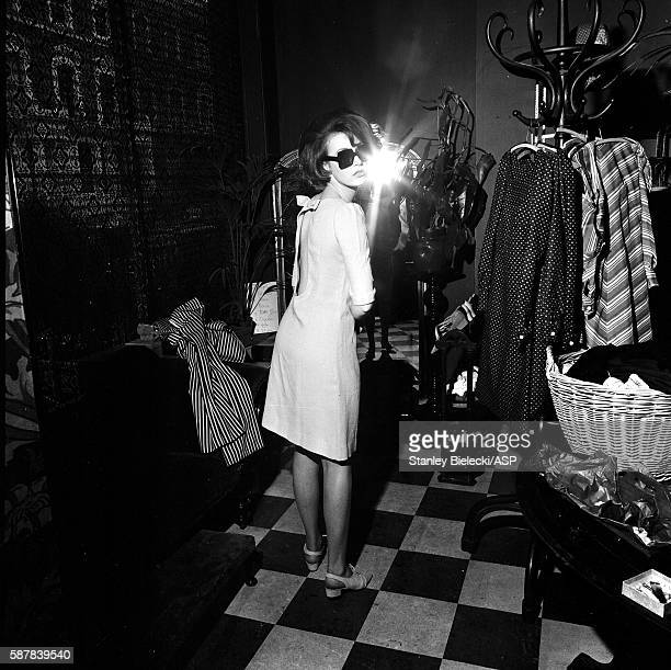A model tries on clothes and sunglasses at the Biba boutique on Abingdon Road in Kensington London circa 1965