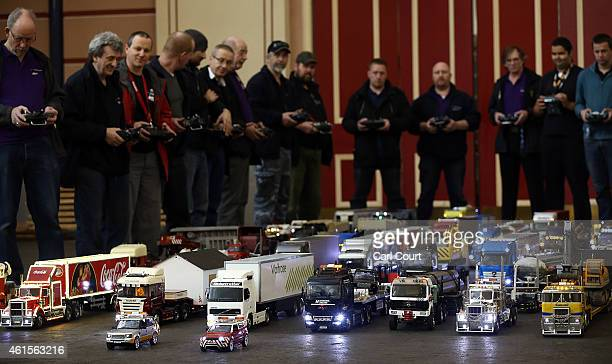 Model trucks are controlled after a world record attempt by members of Tamiya Trucking Group to get into the history books with the longest moving...