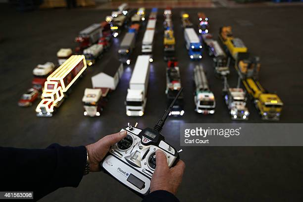 Model trucks are controlled for a world record attempt by members of Tamiya Trucking Group to get into the history books with the longest moving...