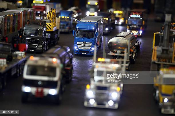 Model trucks are driven after a world record attempt by members of Tamiya Trucking Group to get into the history books with the longest moving convoy...