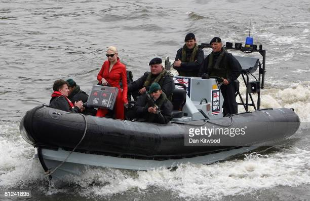 Model Tuuli Shipster arrives on a Pacific 24 sea boat as author Sebastian Faulks launches the latest in the series of James Bond novels near to2 HMS...