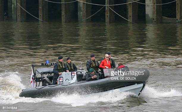 Model Tuuli Shipster crosses the River Thames in London on a Royal Naval 'Pacific 24' sea-boat as she delivers the first copies of the new James Bond...