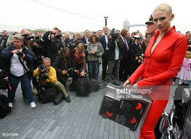 Model Tuuli Shipster holds a briefcase containing the first copies of the new James Bond novel entitled 'Devil May Care' aboard HMS Exeter in London,...