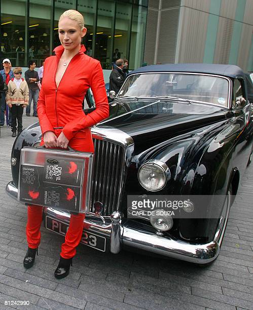 Model Tuuli Shipster holds a briefcase containing the first copies of the new James Bond novel entitled 'Devil May Care,' as she poses for pictures...