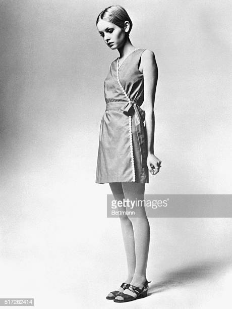 Model Twiggy is shown as she modeled a design from her own summer collection a cotton voile and daisy trimmed dress