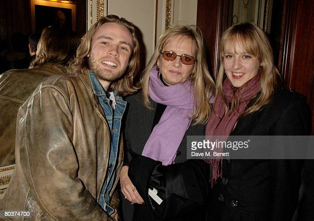 Model Twiggy poses with Ace Lawson and Carly Lawson at the press night of 'The God of Carnage' at the Gielgud Theatre March 25 2008 in London England