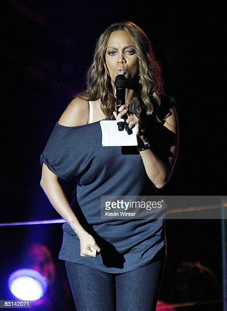 Model Tyra Banks appears onstage at Miley Cyrus' 'Sweet 16' birthday celebration benefiting Youth Service America at Disneyland on October 5 2008 in...