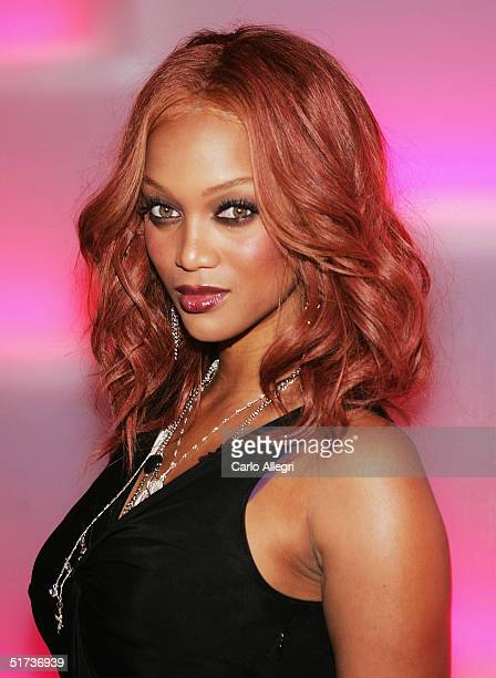 Model Tyra Banks poses for a photo as she arrives for the Victoria Secrets Party at Geisha November 12 2004 in Los Angeles California