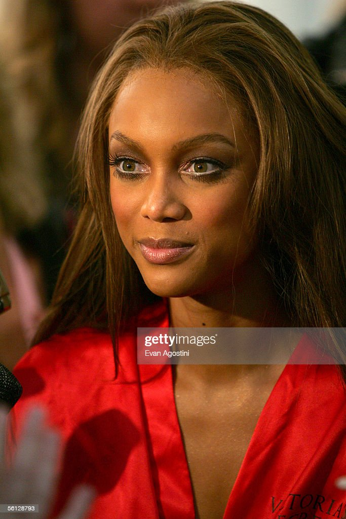Model Tyra Banks prepares backstage for The Victoria's Secret Fashion Show at the 69th Regiment Armory November 9, 2005 in New York City.