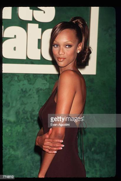 Model Tyra Banks stands at a Sports Illustrated promotional event January 23 1996 in New York City Banks and Valeria Mazza shared the cover of the...