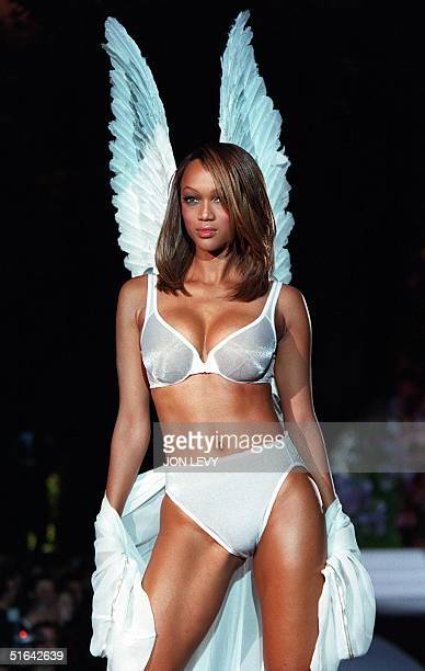 Model Tyra Banks wears a white Angel bra and matching panties with white Angel wings during the Victoria's Secret Spring 1998 Fashion show 03...