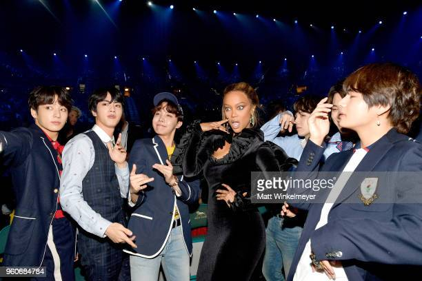 Model Tyra Banks with musical group BTS attend the 2018 Billboard Music Awards at MGM Grand Garden Arena on May 20 2018 in Las Vegas Nevada