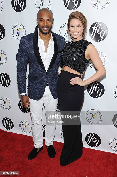 Model Tyson Beckford and Miss USA 2014 Nia Sanchez attend the 4th Annual Fashion For Charity Gala on April 14 2015 in New York City