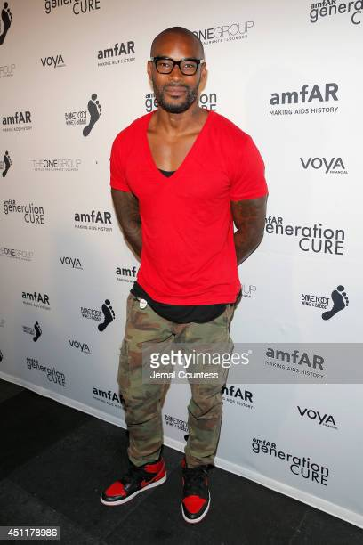 Model Tyson Beckford attends the amfAR 3rd annual Solstice benefit at STK Rooftop on June 24 2014 in New York City