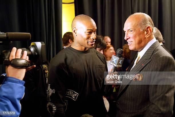 Model Tyson Beckford interviews designer Oscar De la Renta at the Oscar De La Renta fashion show for the Fall/Winter 2003 Collection at The Pavillion...