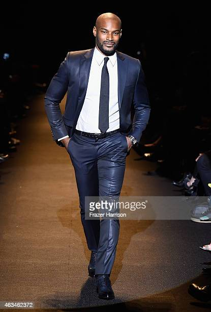 Model Tyson Beckford walks the runway at Naomi Campbell's Fashion For Relief Charity Fashion Show during Mercedes-Benz Fashion Week Fall 2015 at The...