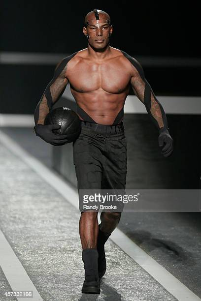 Model Tyson Beckford walks the runway at the Alexander Wang X HM Launch on October 16 2014 in New York City