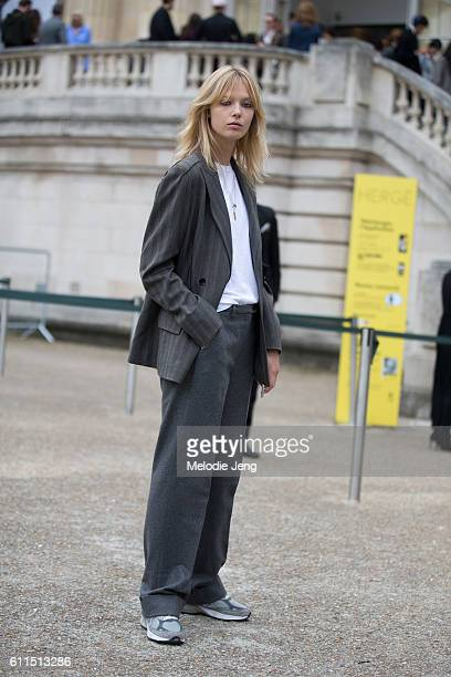Model Ulrikke Hoyer in a gray suit outside the Chloe show at Grand Palais on September 29 2016 in Paris France