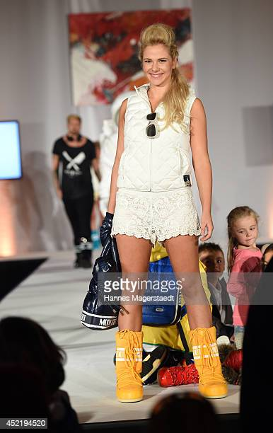 Model Valentina Pahde walks the runway during the Sixt ladies dirndl dinner on July 15 2014 in Munich Germany