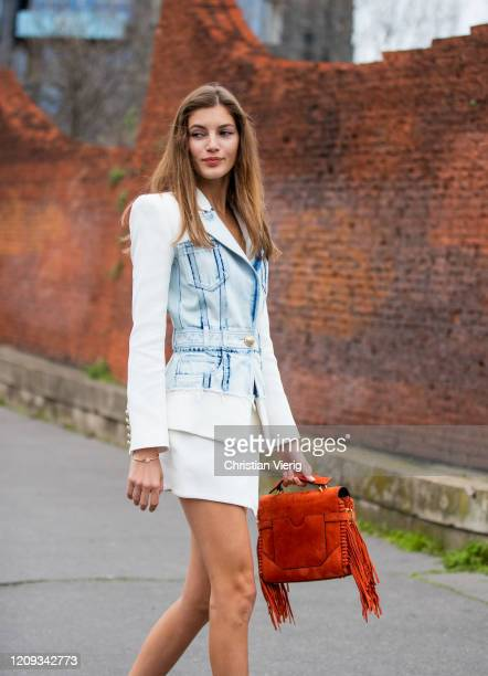Model Valery Kaufman is seen wearing blazer and mini skirt, bag with fringes outside Balmain during Paris Fashion Week - Womenswear Fall/Winter...