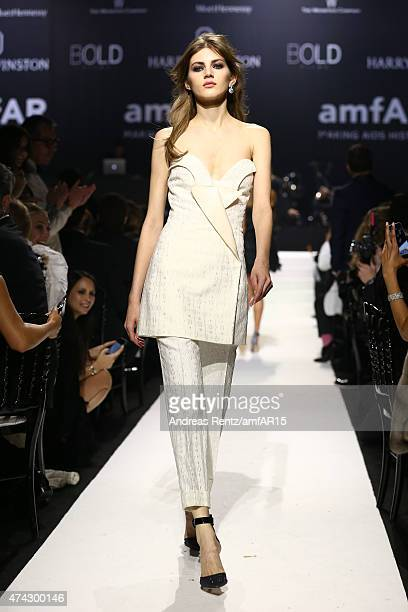 Model Valery Kaufman walks during the fashion show runway during amfAR's 22nd Cinema Against AIDS Gala Presented By Bold Films And Harry Winston at...