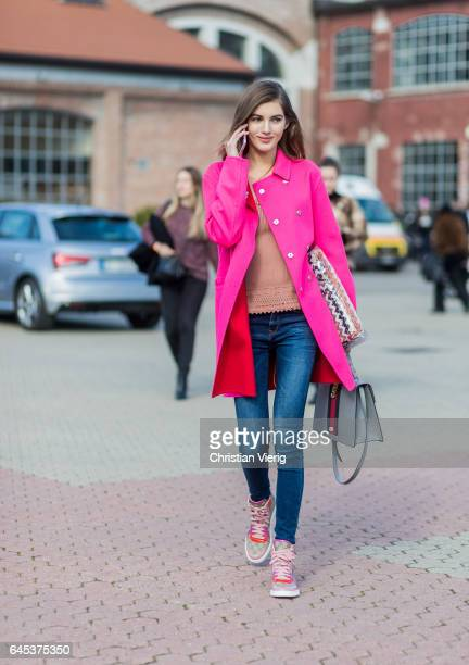 Model Valery Kaufman wearing a pink coat Gucci bag and Gucci sneakers outside Missoni during Milan Fashion Week Fall/Winter 2017/18 on February 25...