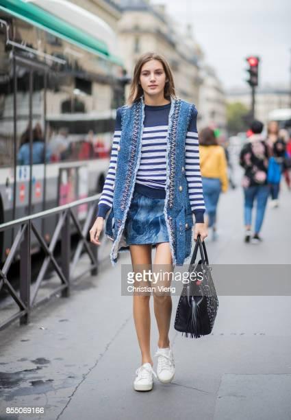 Model Valery Kaufman wearing a striped knit vest is seen outside Balmain during Paris Fashion Week Spring/Summer 2018 on September 28 2017 in Paris...
