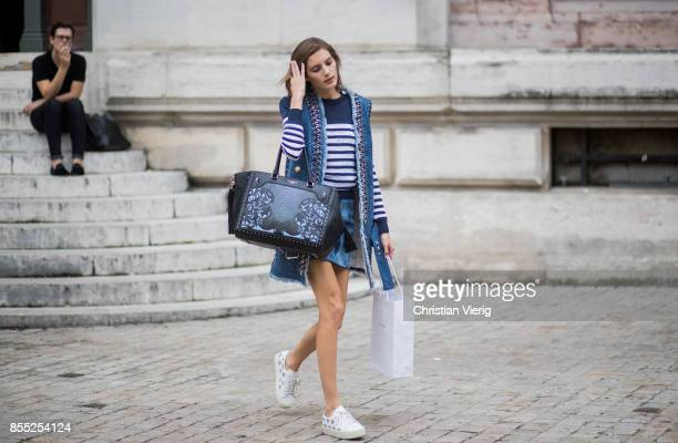 Model Valery Kaufman with a shopping bag is seen outside Balmain during Paris Fashion Week Spring/Summer 2018 on September 28 2017 in Paris France