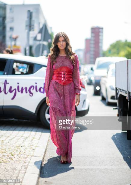 Model Vanessa Fuchs wearing pink gold dress with red corsett is seen outside Marina Hoermanseder during the Berlin Fashion Week July 2018 on July 5...