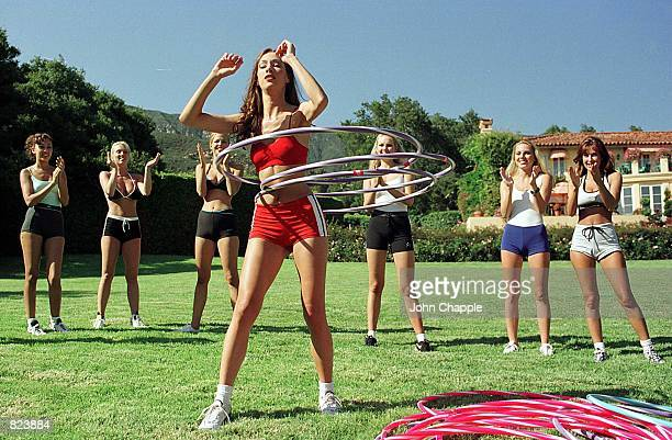 Model Vanessa Norris hoola hoops as her teammates cheer her on during the Perfect 10 Magazine model of the year competition June 13 1998 in Santa...