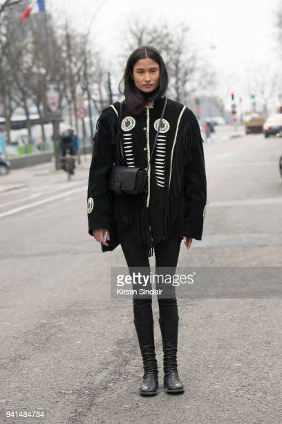Model Varsha Thapa wears Levis jeans Philip Lim bag Guidi boots and a vintage jacket day 4 of Paris Womens Fashion Week Spring/Summer 2018 on March 1...