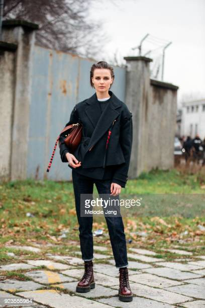Model Vasilisa Pavlova wears a Proenza Schouler jacket and JW Anderson bag during Milan Fashion Week Fall/Winter 2018/19 on February 23 2018 in Milan...