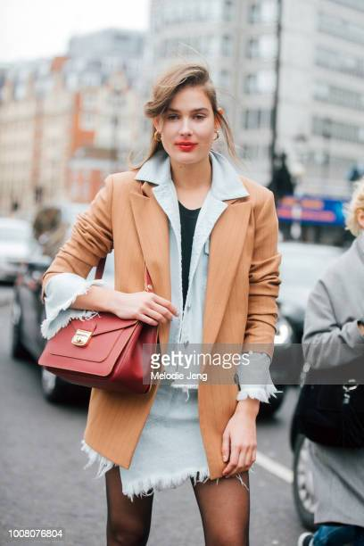 Model Vera Van Erp sports smeared light red lipstick after the Preen by Thornton Bregazzi show and wears a light brown blazer over a matching light...