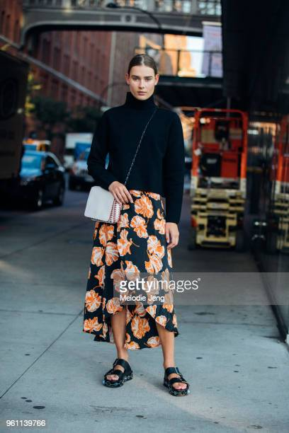 Model Vera Van Erp wears an And Other Stories top white Paco Rabanne bag Ganni orange floral skirt and black sandals during New York Fashion Week...