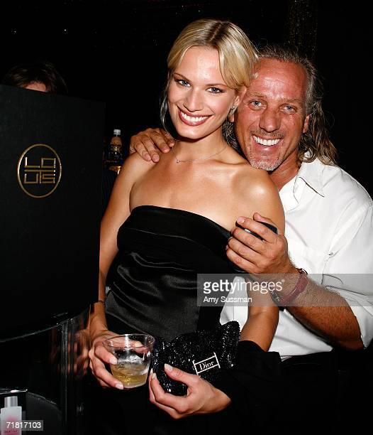 Model Vicky Andren and designer Mark Baker pose at Lotus bar during The Bratz Forever Diamondz Lounge hosted by Distinctive Assets at the Conde Nast...