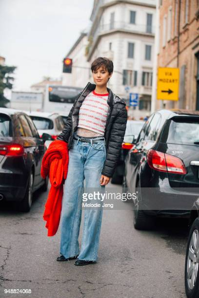 Model Victoria Carrillo wears a black down puffer jacket a Unif cropped top obermeyer underwear and blue jeans during Milan Fashion Week Fall/Winter...
